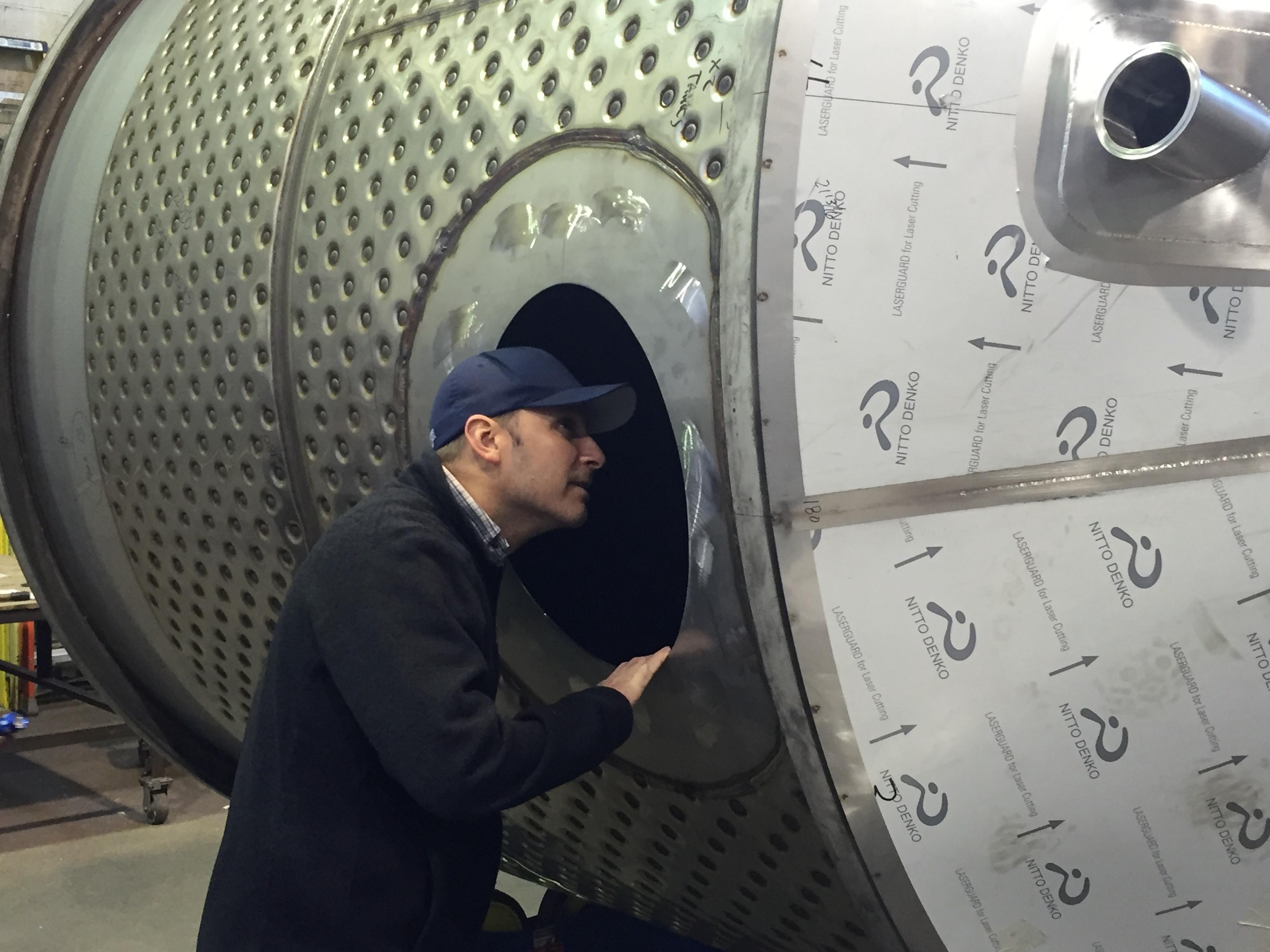 Peter inspecting tank